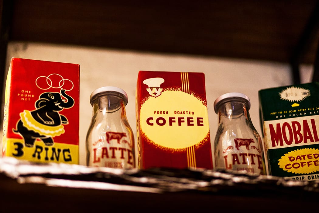 Vintage coffee knickknacks decorate shelves around the room. | Photo by Dorey Kronick.
