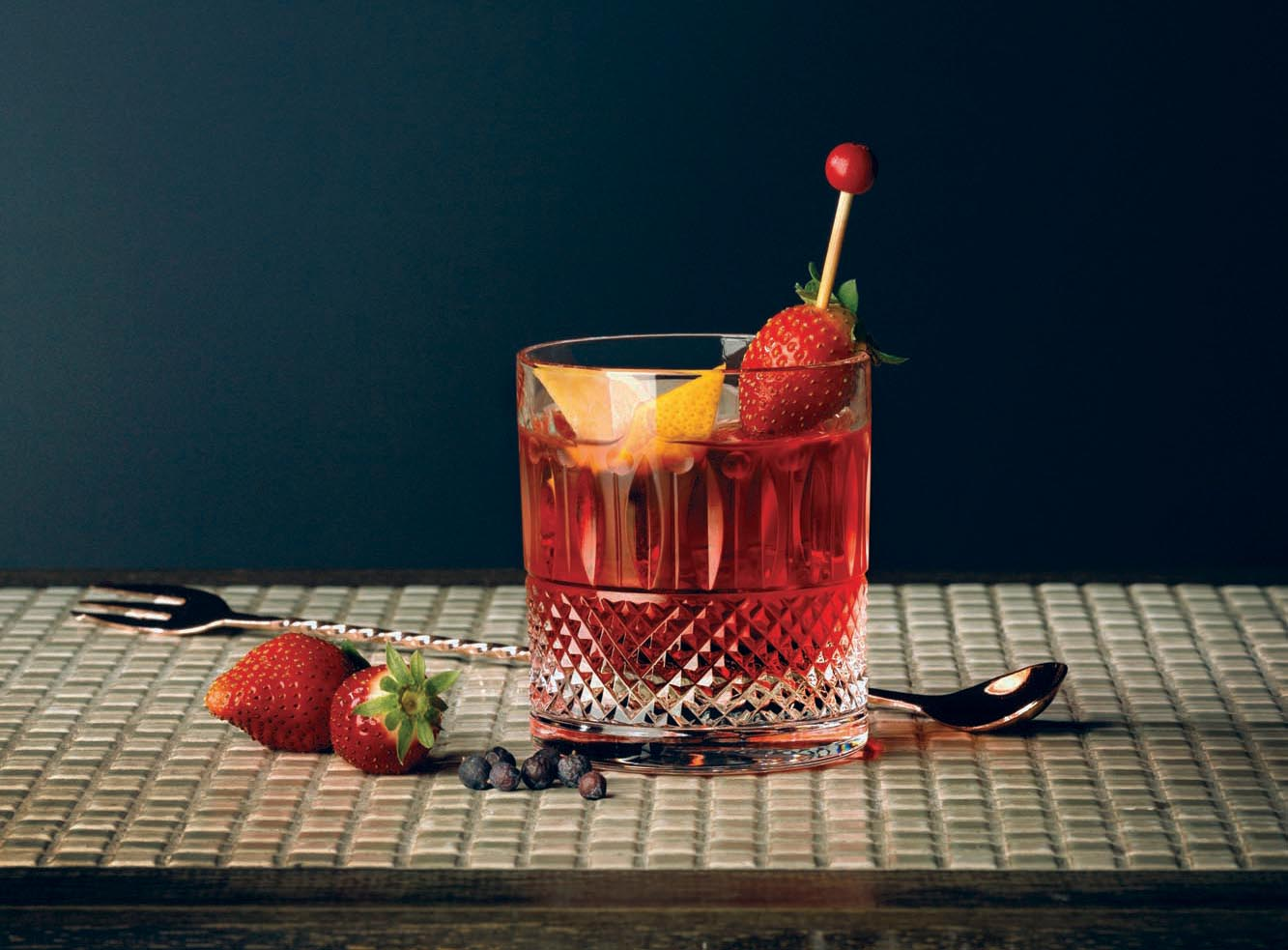 In the Kula Negroni, Julie Reiner infuses strawberries into Campari and pairs the mixture with London Dry gin and vermouth.