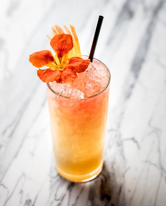The bar offers 150 classic cocktails and a handful of house recipes, like the Vauvert Swizzle. The bright mix of green tea vodka, Chartreuse, lemon and grapefruit juice, honey syrup and orange blossom water is topped with sparkling rosé and a nasturtium flower.