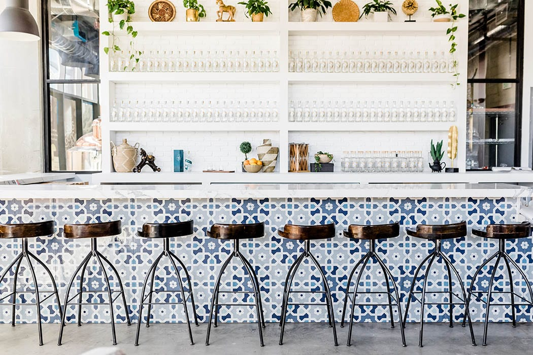 The painted tiles on the bar face are designer Kate Lester's favorite part of the room.
