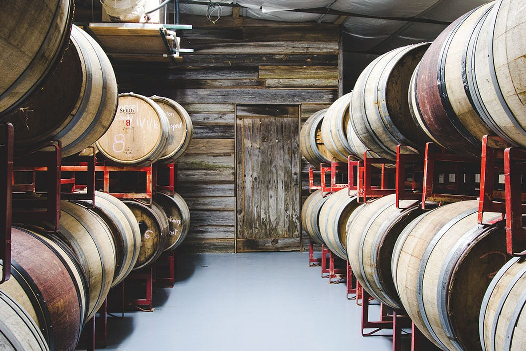 Barrels at Revelry Brewing. | Photo by Jay Wayne Productions.