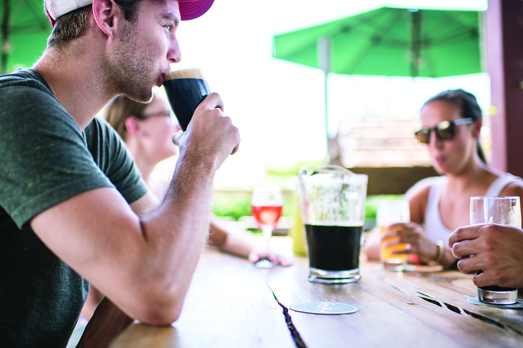 Customers drink beers on the patio at Green Bench Brewing. | Photo by Megan Klementowski/Nutmeg Imageworks.