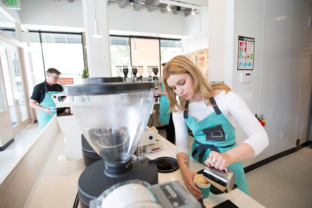 Even though various technologies are used to expedite coffee service, the baristas still play a key role at the shop, creating a friendly space for customers.