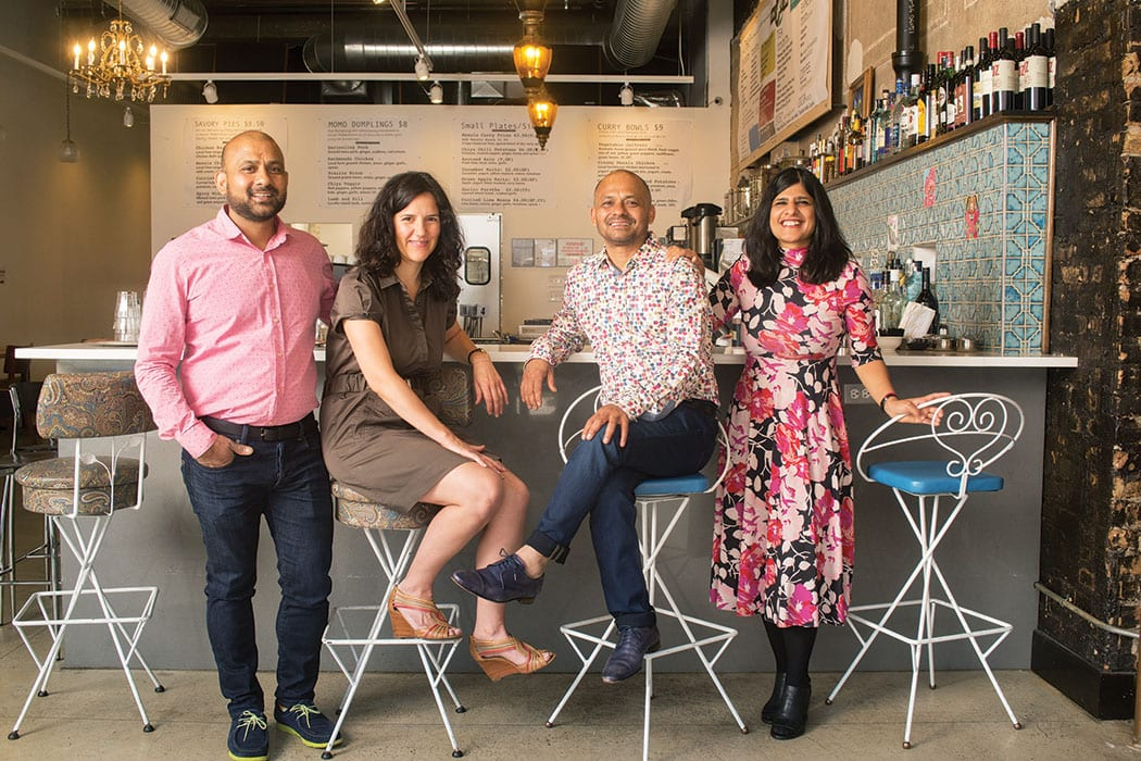 Brothers Sanjanaya Shrestha (pink shirt with wife Nadine Schaefer in brown dress) and Swadesh Shrestha (dotted shirt with wife Rajee Aryal in floral print dress) own and operate Chiya Chai Cafe, 2770 North Milwaukee Ave, Chicago for Imbibe magazine
