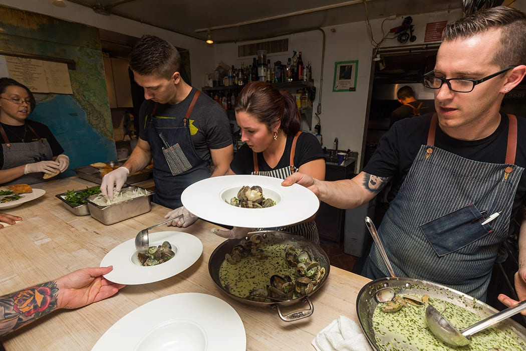 Chef James Rigato serves up clams with green curry.