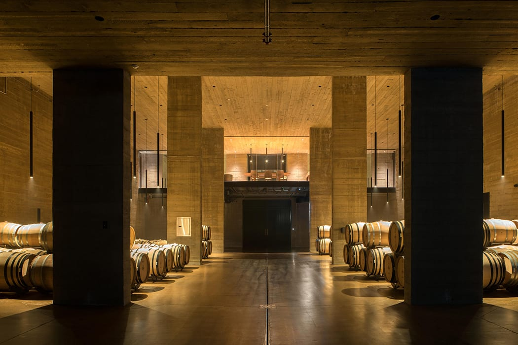 Barrels of wine rest in the subterranean barrel-aging room.  | Photo by Nic Lehoux.