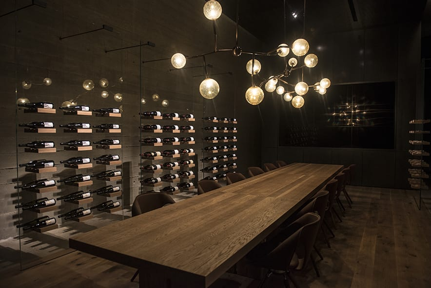 The tasting room has an ethereal feel, with glowing orb-like light fixtures. | Photo by Nic Lehoux.
