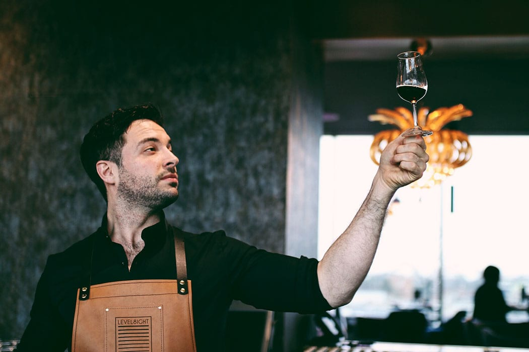 Alexander West keeps a close eye on what's happening behind the bar at Level8ight Sky Bar. Here, he captures head bartender Mark Carson in action. | Follow Alexander at @alexander.west.