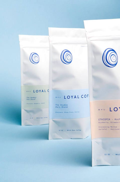 Loyal Coffee's bags are adorned with a custom typeface and circular symbol that represents the company's six founders, both designed by Studio Mast. | Photo by Studio Mast / Chris Mueller.