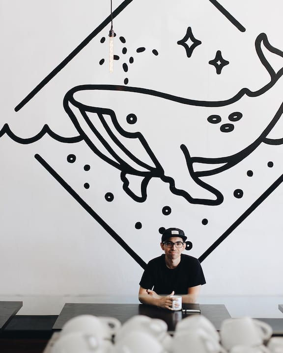 Scrimshaw's interior mural designed by Corinne Alexandra helps make the café's brand recognizable. | Photo courtesy of Scrimshaw Coffee.
