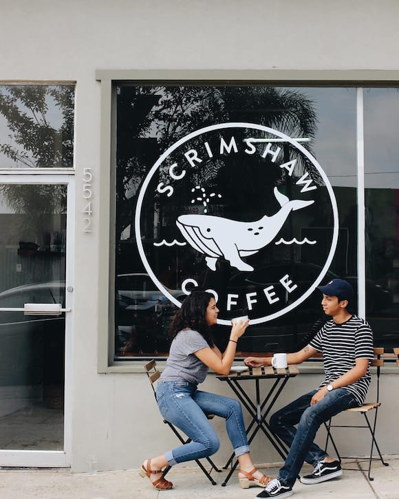 Scrimshaw Coffee's exterior prominently features their Instagram-friendly mascot, Verne. | Photo courtesy of Scrimshaw Coffee.