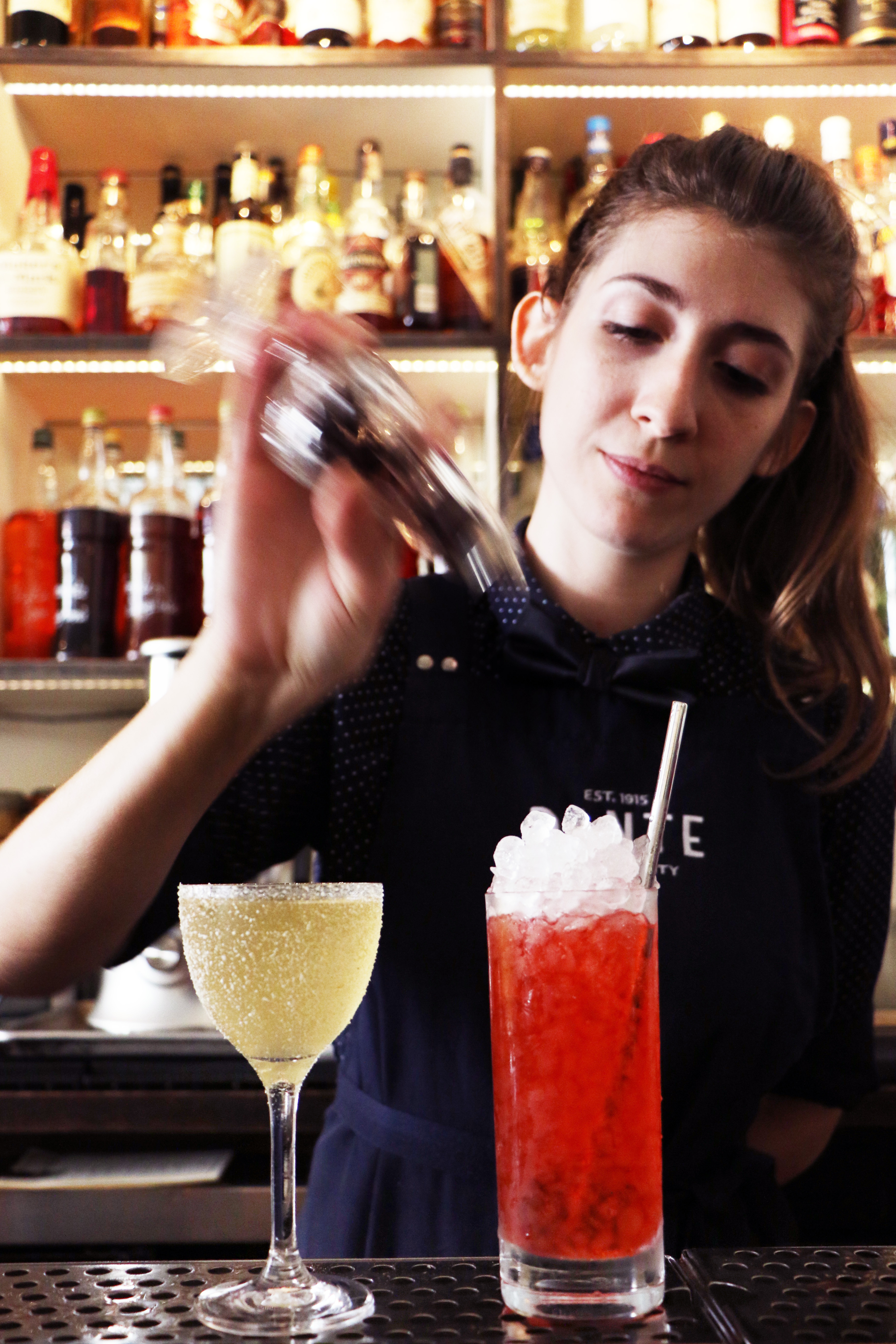 Bartender Ana Lobo prepares a few Negroni Sessions cocktails. | Photo by Emma Janzen.