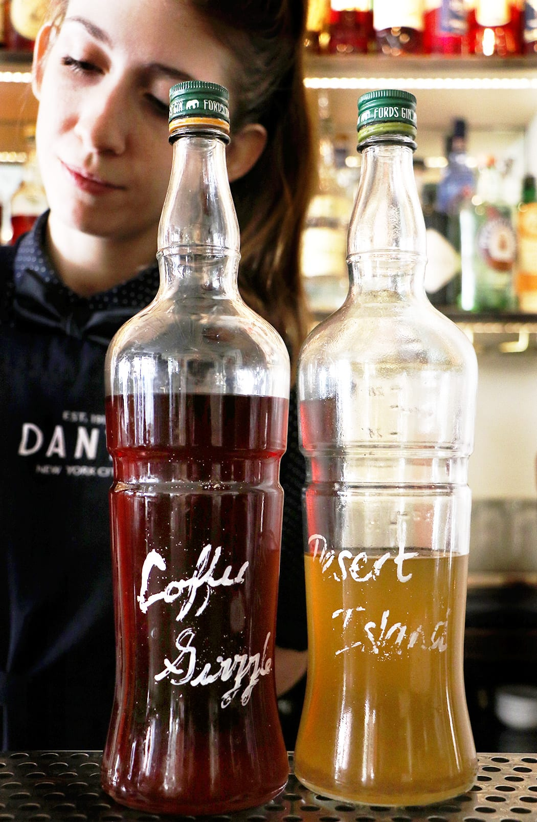 Most of the Negroni Sessions cocktails are batched and bottled for quick service. | Photo by Emma Janzen.