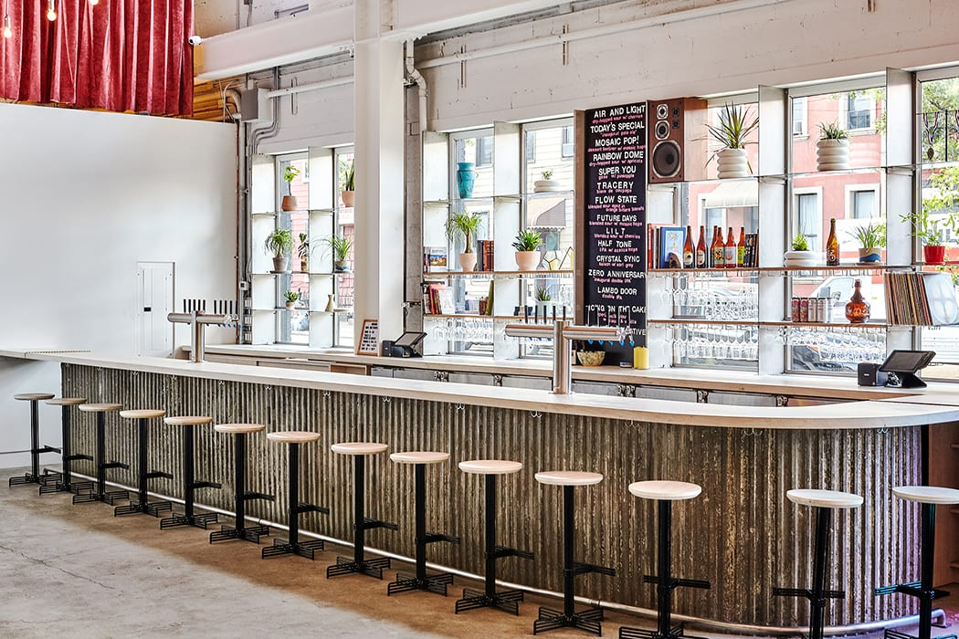 New York architecture firm inc_a designed the taproom, which features a playful blend of organic and industrial materials.
