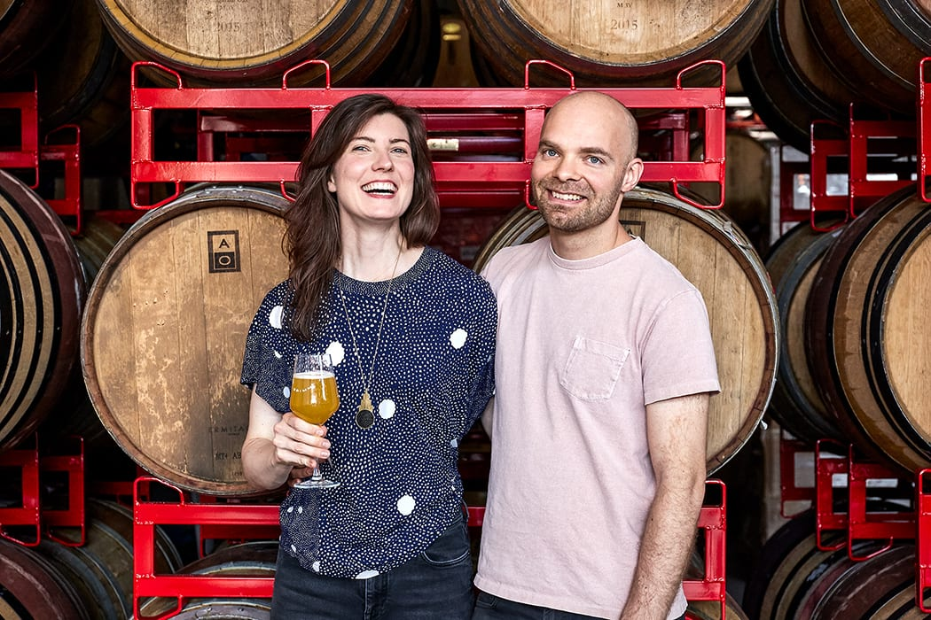 Founders Lauren and Joe Grimm met as artists and opened Grimm Artisanal Ales in 2013 after years of tinkering with fermentation projects in their kitchen.