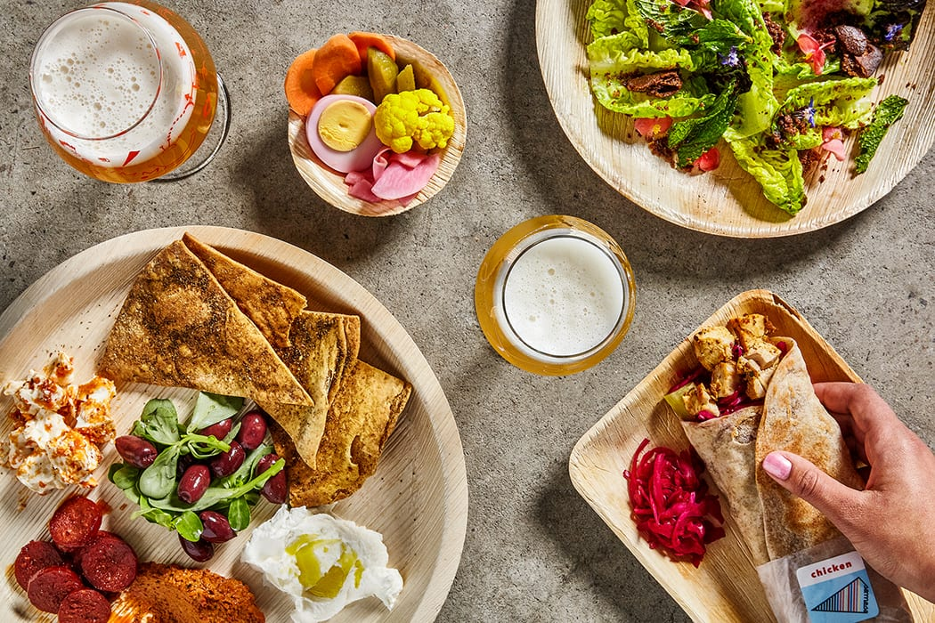 Eli and Max Sussman of the Middle Eastern-inspired restaurant Samesa put together the taproom menu. Dishes like Chicken Shawarma Melt and Pumpernickel Pita and Dips are offered to pair with the house beers.