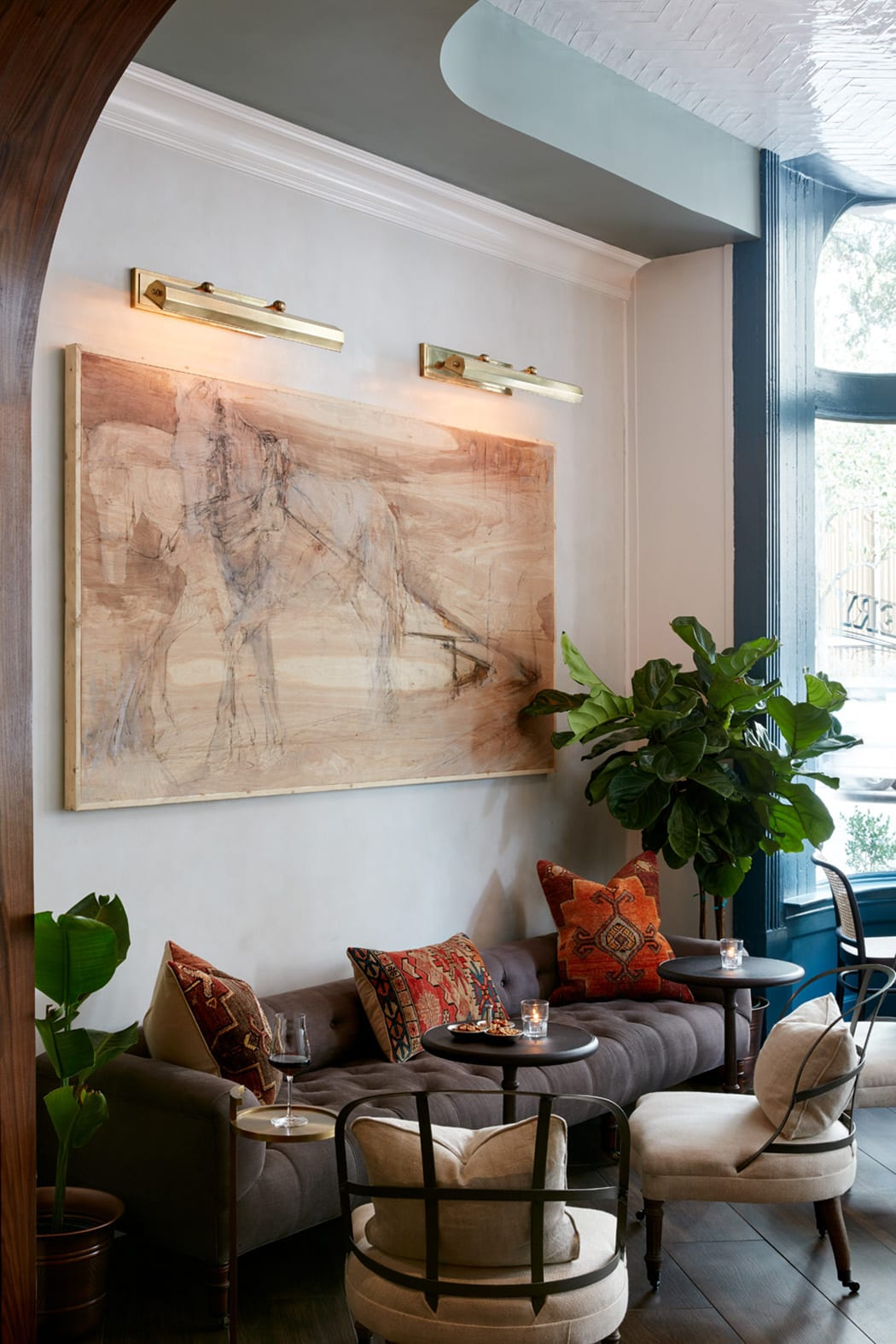 A custom panel by local artist Mary Hartman—an abstract of a horse pulling a cart—is a defining element of the main room.  | Photo by Jeremiah Hull.