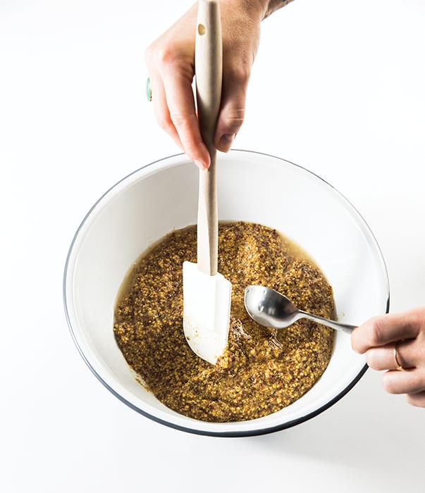 Step 4: Put the mustard in a large bowl and begin adding cold water, one tablespoon at a time, while mixing with a rubber spatula. Continue to add the water until you reach your desired consistency. Taste for seasoning and add more if needed.