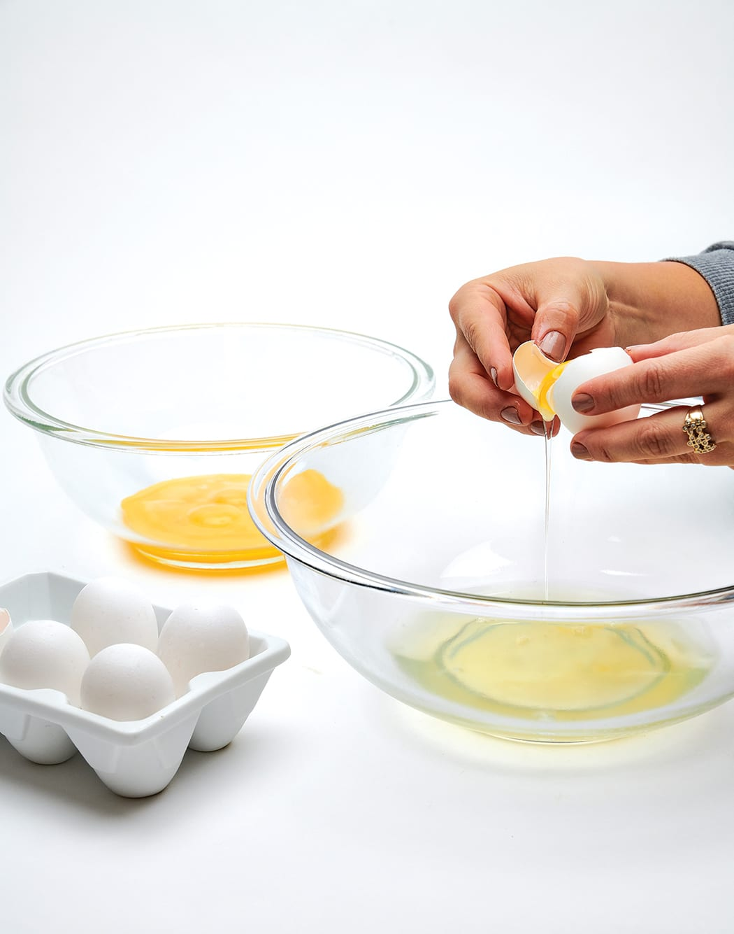 Separate the eggs, placing the whites in a large bowl and the yolks in a medium bowl.