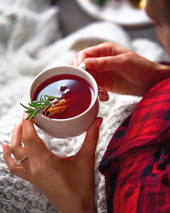 The hygge vibes are strong in this Cranberry Spiced Hot Toddy from Carolyn Pascual. | Follow the home mixologist and blogger at @thesocialsipper.