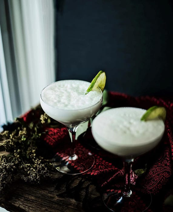 St. Petersburg=based photographer Maria Kennedy has a knack for capturing the moody side of any season, and this Eggnog Gin Fizz has us hankering for a round. | Follow Maria at @saltandsuch.