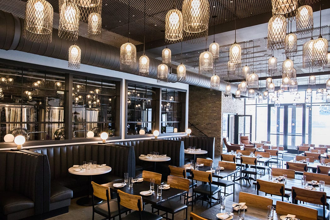 The first floor of Bixi is dark and industrial, a nod to Chicago's urban nature and the technical aspects of the brewing process.