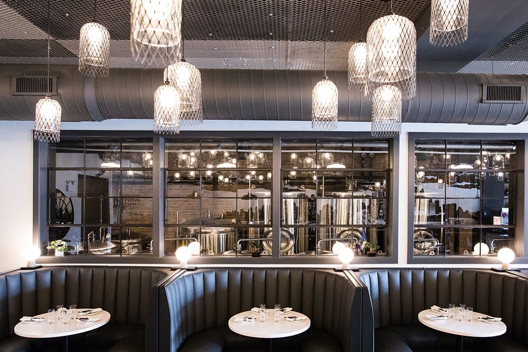 Windows let guests see inside the brewing operations that flank the first-floor dining room.