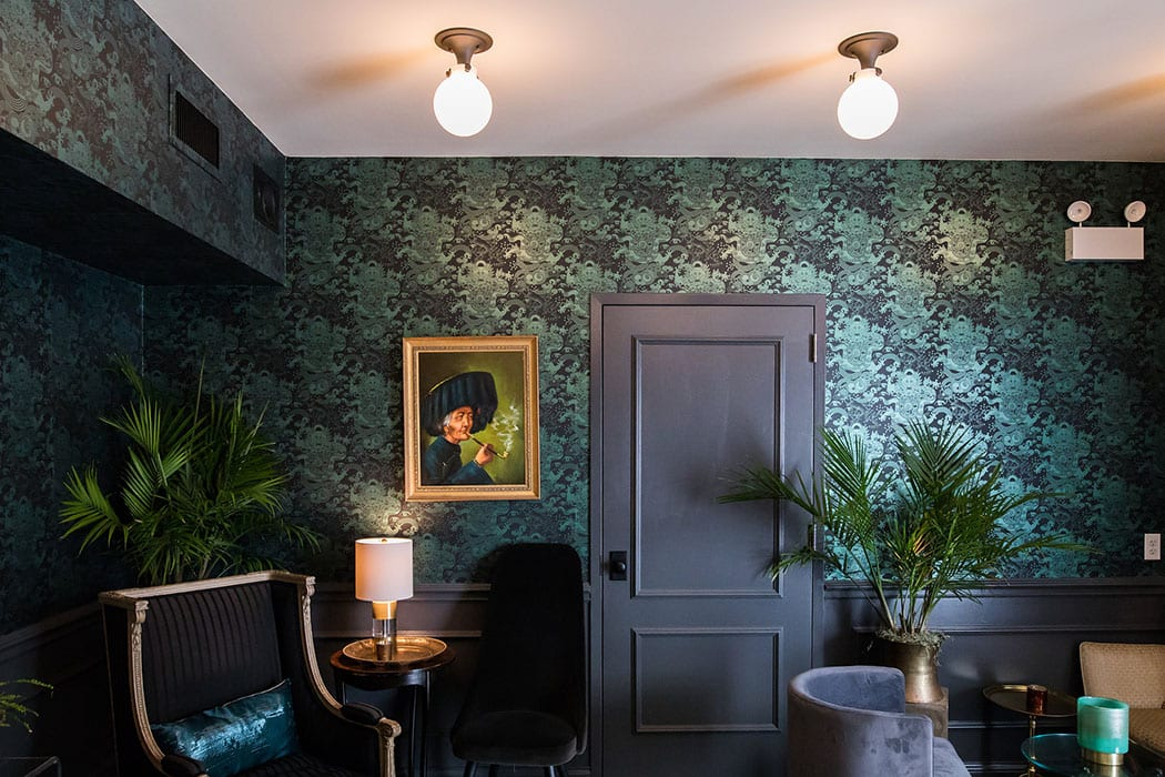 The wallpaper in the lounge features pictures of Bixi, the mythical Chinese dragon-turtle.