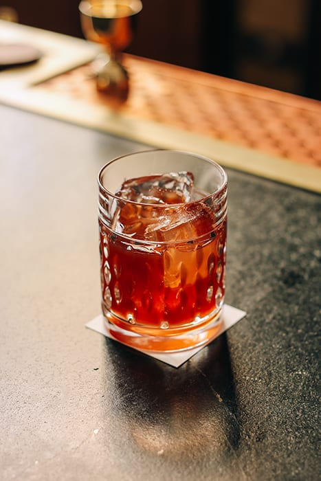 The Improved Old Fashioned features a guest's spirit of choice and an option of preserved fruit.