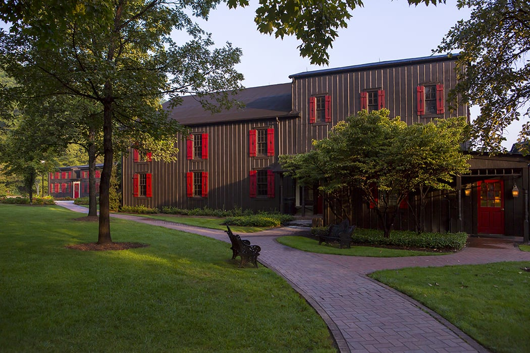 The black buildings with red shutters were part of Margie's original vision for the property. | Photo by John Lair.