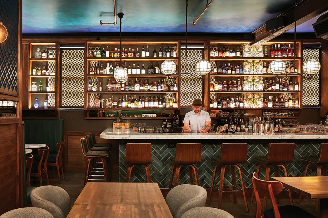 Owner and beverage director Tommy Klus behind the bar at Scotch Lodge. Photo courtesy of Design Department.