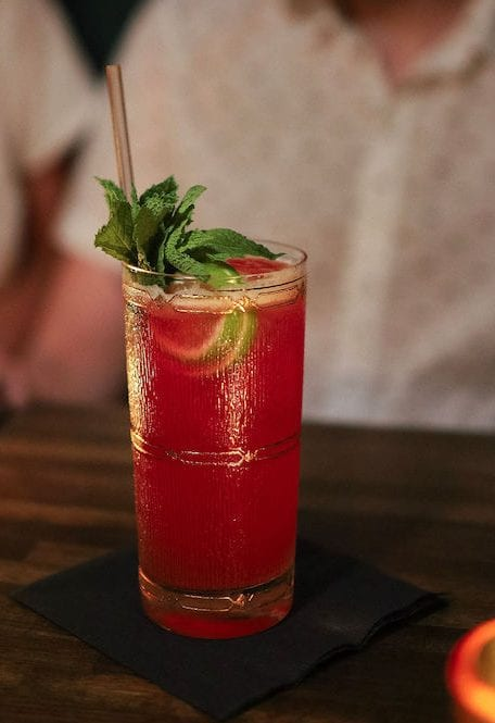 Hibiscus punches up the flavor profile in the Queen of the Damned, complementing a base of rye and cognac.