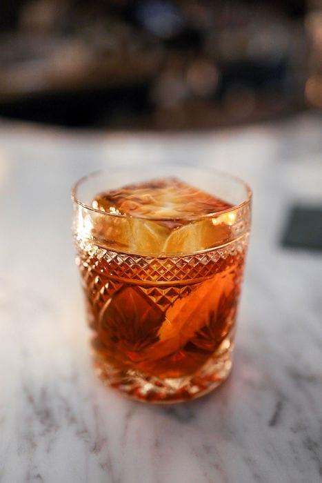 The original Scotch Lodge cocktail, now called the Namesake (Islay scotch, cherry liqueur, sweet vermouth, amaro), inspired the bar's concept and anchors the cocktail menu.