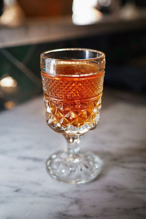A riff on the classic Brooklyn cocktail, the No Sleep Till doubles down on the smoky notes with a split base of scotch and mezcal.